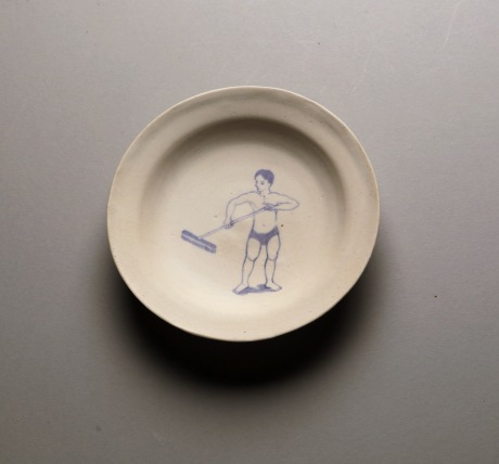 men-cleaning-sweeping-plate