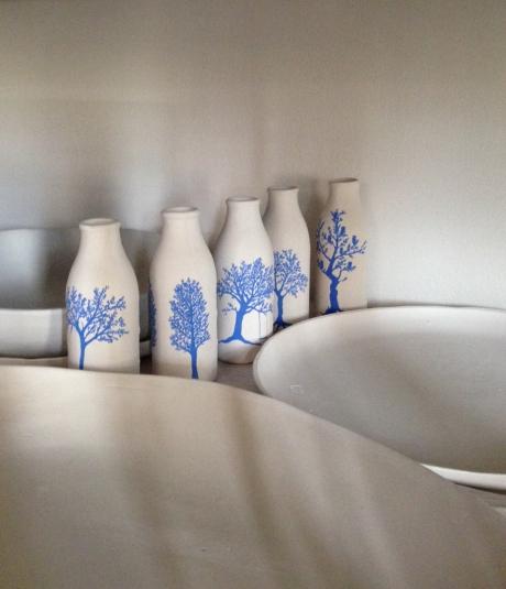 tree bottles waiting for the kiln